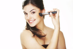 Young woman with brush Royalty Free Stock Photos
