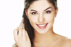 Young woman with brush Stock Photography