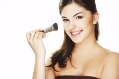 Young woman with brush Stock Images