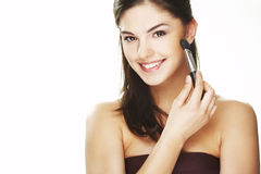 Young woman with brush Royalty Free Stock Images