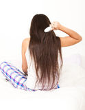 Young woman brush her long hair Royalty Free Stock Photography