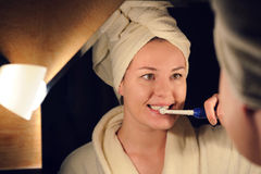 Young woman brush her teeth Stock Image