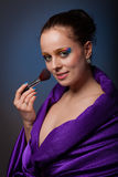 Young woman with brush for make-up. Royalty Free Stock Images