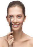 Young woman with brush for makeup Stock Image