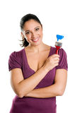 Young woman with brush for paint Royalty Free Stock Image