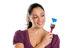 Young woman with brush ready for paint stock photography