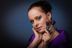Young woman with brushes for make-up. Stock Photography