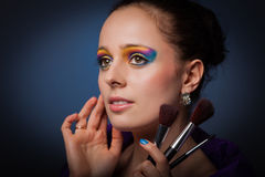 Young woman with brushes for make-up. Royalty Free Stock Photo