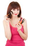 Young woman with brushes for makeup Royalty Free Stock Images