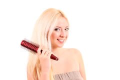 young   woman brushing her long hair Stock Photography