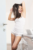 Young woman brushing her tangled hair Stock Photo