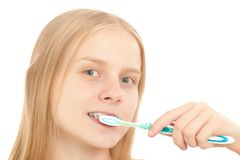 Young woman brushing her teeth Royalty Free Stock Image