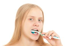 A young woman brushing her teeth Stock Images