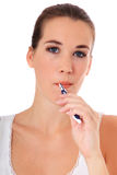 Young woman brushing her teeth. Attractive young woman brushing her teeth. All on white background Stock Photography