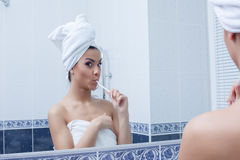 Young woman brushing her teeth. Portrait of young woman brushing her teeth Royalty Free Stock Photography