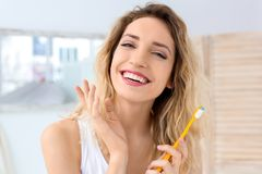 Young woman brushing her teeth. In bathroom Royalty Free Stock Photography