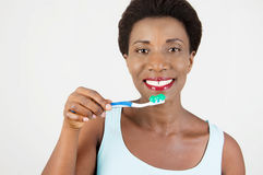 Young woman brushing her teeth. Stock Image