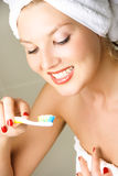 Young woman  brushing teeth Stock Image