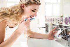 Young woman brushing teeth Royalty Free Stock Photos