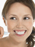 Young Woman Brushing Teeth Royalty Free Stock Images