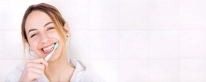 Young woman brushing teeth . Royalty Free Stock Photos