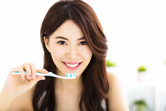 Young woman  brushing teeth in the morning Royalty Free Stock Photos