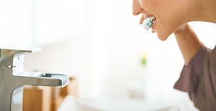 Young woman brushing teeth. Plenty of copy space royalty free stock photo