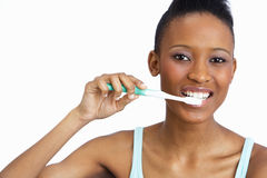 Young Woman Brushing Teeth In Studio Royalty Free Stock Image