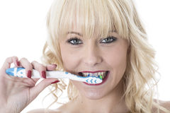 Young Woman Brushing Teeth with Tooth Brush Royalty Free Stock Photos