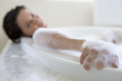 Young woman in bubble bath, portrait Royalty Free Stock Image