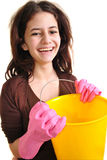 young woman with a bucket and gloves Royalty Free Stock Photos