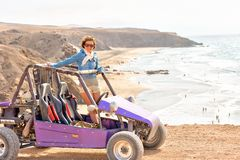 Young woman on buggy. On the ocean coast Stock Images