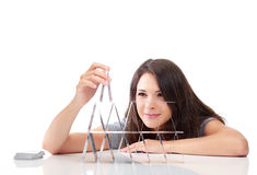 Young woman is building a house of cards Royalty Free Stock Photography