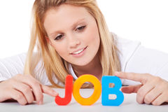 Young woman building the term job Royalty Free Stock Photo