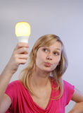 Young woman with Bulb Stock Photography