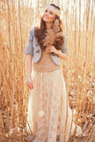 Young woman with bulrush Royalty Free Stock Photo