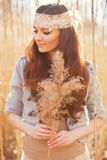 Young woman with bulrush Royalty Free Stock Photography