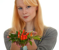 Young woman with bunch of chilli, pepperoni Royalty Free Stock Photo
