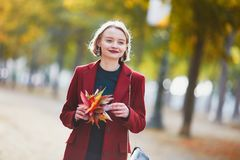 Young woman with bunch of colorful autumn leaves Royalty Free Stock Photo