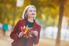 Young woman with bunch of colorful autumn leaves Stock Photos