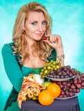 Young woman with a bunch of food Royalty Free Stock Photos