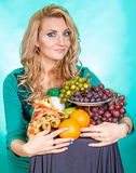 Young woman with a bunch of food Stock Photos