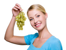 Young woman with bunch of grapes Royalty Free Stock Photos
