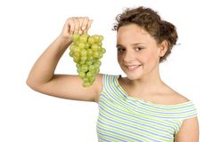 Young woman with bunch of grapes Stock Photo