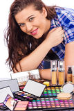 Young woman  with a bunch of make up Stock Image