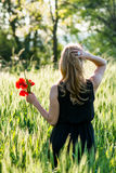 Young woman with bunch poppies Royalty Free Stock Photos