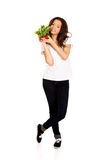 Young woman with bunch of radishes. Stock Photos