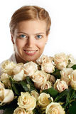 Young woman with bunch of roses Stock Images