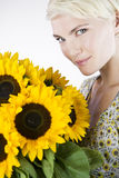 A Young Woman With A Bunch Of Sunflowers Royalty Free Stock Images