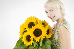 A Young Woman With A Bunch Of Sunflowers Royalty Free Stock Photo